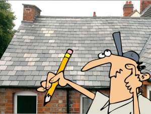 Man in front of slate roof