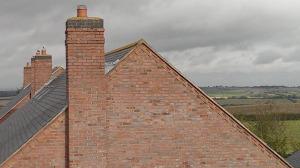 Worn cement mortar chimney